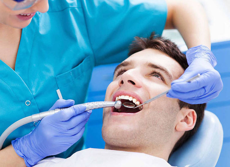 Lấy cao răng xong bị ê buốt